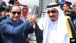 FILE - Egyptian President Abdel-Fattah el-Sissi, left, shakes hands with Saudi Arabia's King Salman before he departs Egypt, April 11, 2016. The transfer of Tiran and Sanfir was included in April in a maritime border agreement with Saudi Arabia.