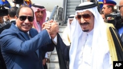 FILE - Egyptian President Abdel Fattah el-Sissi, left, shakes hands with Saudi Arabia's King Salman before he departs Egypt, April 11, 2016.