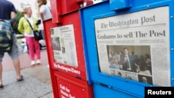 Koran Washington Post dijual dekat Gedung Kongres di Washington. (Foto: Dok)
