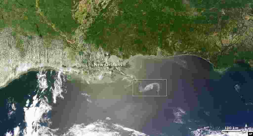 The MODIS image on the Terra satellite captured a wide-view natural-color image of the oil slick (outlined in white) just off the Louisiana coast, 29 Apr 2010. (NASA Image)