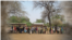 FILE - A long line at a food-distribution site in Malawi. (Credit: WFP)