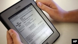 FILE - In this Aug. 5, 2013, file photo, a Kindle reading device displays articles from The Washington Post.