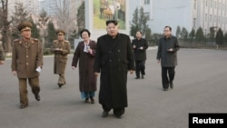 North Korean leader Kim Jong Un (C) visits the Phyongchon Revolutionary Site, in this undated photo released by North Korea's Korean Central News Agency (KCNA) in Pyongyang, Dec. 10, 2015.