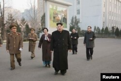 North Korean leader Kim Jong Un, center, visits the Phyongchon Revolutionary Site, in this undated photo released by North Korea's Korean Central News Agency (KCNA) in Pyongyang, Dec. 10, 2015.
