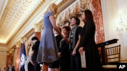 Ivanka Trump shakes hands with people honored for their work to stop human trafficking including Allison Lee, of Taiwan, and Boom Mosby, of Thailand, right, during a 2017 Trafficking in Persons Report ceremony at the State Department, June 27, 2017, in Washington.