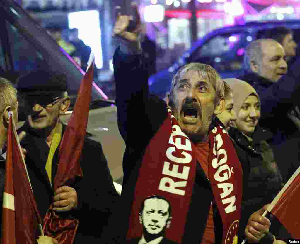 Crowd gather to welcome the Turkish Family Minister Fatma Betul Sayan Kaya, who decided to travel to Rotterdam by land after Turkish Foreign Minister Mevlut Cavusoglu's flight was barred from landing by the Dutch government, in Rotterdam, Netherlands, Mar