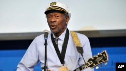 "FILE - Rock 'n' roll legend Chuck Berry performs ""Johnny B. Goode"" at the John F. Kennedy Presidential Library and Museum in Boston, Feb. 26, 2012."