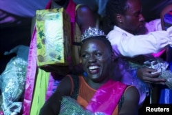 Mahad, who identifies as a transgender woman, smiles moments after being crowned as the winner of the Miss Pride beauty contest at an undisclosed venue in Kampala, Uganda, Aug. 7, 2015.