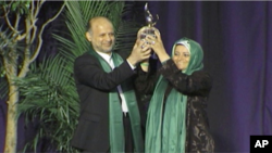 Iranian opposition activist Akbar Ganji accepts the Milton Friedman Award for Advancing Liberty