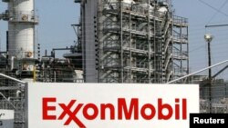 FILE - A view of the Exxon Mobil refinery in Baytown, Texas, Sept. 15, 2008.
