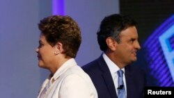 FILE - Brazil's presidential candidates Aecio Neves (R) of Brazilian Social Democratic Party (PSDB) and Dilma Rousseff of Workers Party (PT) take part in a TV debate in Rio de Janeiro Oct. 2, 2014.