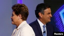 Brazil's presidential candidates Aecio Neves (R) of Brazilian Social Democratic Party (PSDB) and Dilma Rousseff of Workers Party (PT) take part in a TV debate in Rio de Janeiro, Oct. 2, 2014.