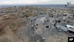 This image taken from drone footage posted online Jan. 2, 2017, by the Aamaq News Agency, a media arm of the Islamic State group, purports to show an aerial image of a neighborhood damaged by Turkish airstrikes in the northern Syrian town of al-Bab.