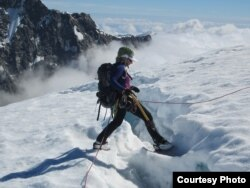 Mountaineer Stephanie Groen stands by a deep crevasse on a glacier in New Zealand, where she worries about signs of rapid ice-melt. (Courtesy: Stephanie Groen)