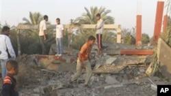 Palestinians inspect the damage to a building following an Israeli airstrike in Deir el-Balah, central Gaza Strip, 19 Nov 2010