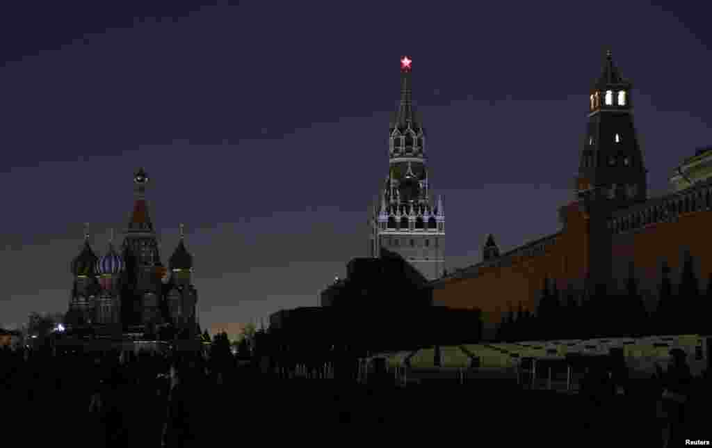 A view shows the St. Basil's Cathedral, left, and the Kremlin wall, after the lights were switched off for Earth Hour in Red Square in central Moscow, Russia, March 25, 2017.