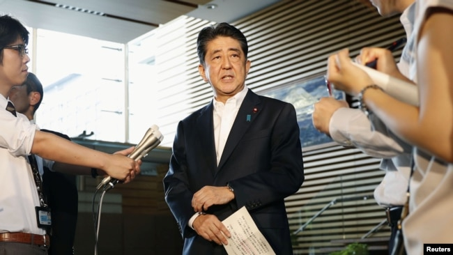 Japanese Prime Minister Shinzo Abe speaks to reporters about North Korea's missile launch in Tokyo, Japan, in this photo taken by Kyodo, Aug. 29, 2017.