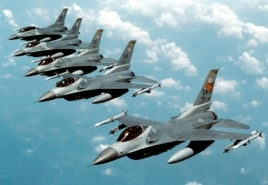 "FILE- Five U.S. Air Force F-16 ""Fighting Falcon"" jets fly in echelon formation over the U.S. en route to an exercise in this undated photograph."