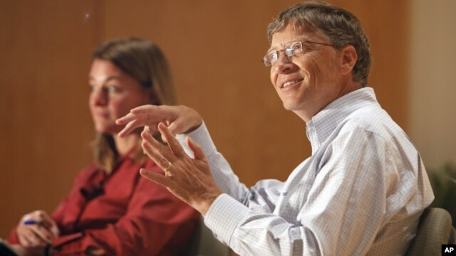 Bill Gates, accompanied by his wife Melinda speak to students at an appearance at Central Piedmont Community College in Charlotte, North Carolina.