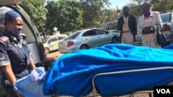 Johanna Mamombe in a stretcher outside a private hospital in Harare. (VOA)