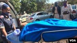 Johanna Mamombe in a stretcher at a private hospital in Harare. (VOA)