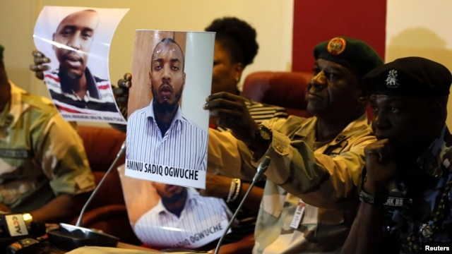 Photographs of Rufai Abubakar Tsiga (L) and Aminu Sadiq Ogwuche are presented to the media by the State Security Service in Abuja, Nigeria, May 12, 2014.