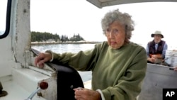 Virginia Oliver, age 101, pilots her son Max Oliver's boat, Tuesday, Aug. 31, 2021, off Rockland, Maine. (AP Photo/Robert F. Bukaty)