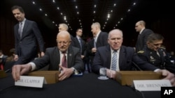 El director de Inteligencia de EE.UU., James Clapper, y el de la CIA, John Brennan, en la audiencia legislativa en Washington.