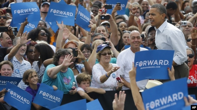 President Barack Obama walks on stage as he is introduced at a campaign event at St. Petersburg College-Seminole Campus at the Natural Habitat Park Field, Saturday, Sept. 8, 2012, in St. Petersburg, Florida.