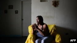 Luber Faneitte, a 56-year-old diagnosed with lung cancer, talks during a interview with AFP at her house in the San Agustin shantytown in Caracas on Nov. 10, 2017. Faneitte fears that if Venezuela defaults on its $150 billion debt, which is considered lik