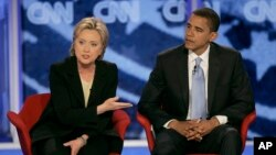 FILE - Then-Sen. Hillary Clinton, D-N.Y., answers a question alongside then-Sen. Barack Obama, D-Ill., during a presidential primary debate in Manchester, N.H., June 3, 2007. Obama formally endorsed Clinton's 2016 White House bid on June 9.