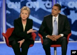 FILE - In this June 3, 2007, file photo, then-Democratic presidential candidates Hillary Clinton and Barack Obama participate in a debate in Manchester, N.H.