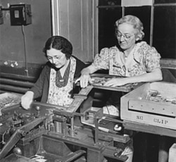 Women putting together gun parts at the Frankford Arsenal in Philadelphia, Pennsylvania