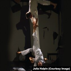 Only Child Aerial Theatre's Sloan Bradford (top) and co-founder Nicki Miller perform on aerial silks in ASYLUM.