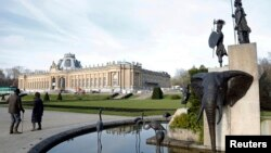 FILE -- A modern sculpture by Belgian artist Tom Frantzen shows former Belgian King Leopold II surrounded by animals and African warriors in the park of the Royal Museum for Central Africa in Tervuren, Belgium, Jan. 22, 2014. After a five-year remodel, it reopened, Dec. 8, 2018.