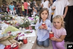 Children light candles honoring investigative reporter Daphne Caruana Galizia, in Valletta, Malta, Oct. 22, 2017.