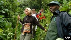 FILE - Dominique Bavukahe-Manir, chief inspector of the Jomba area at the National Park of Virunga in the DRC accompanies tourists to observe gorillas.