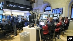 Traders at Meridian Equity Partners work on the floor of the New York Stock Exchange in New York, September 6, 2011.