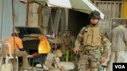 Anggota pasukan militer Irak di kota Fallujah.