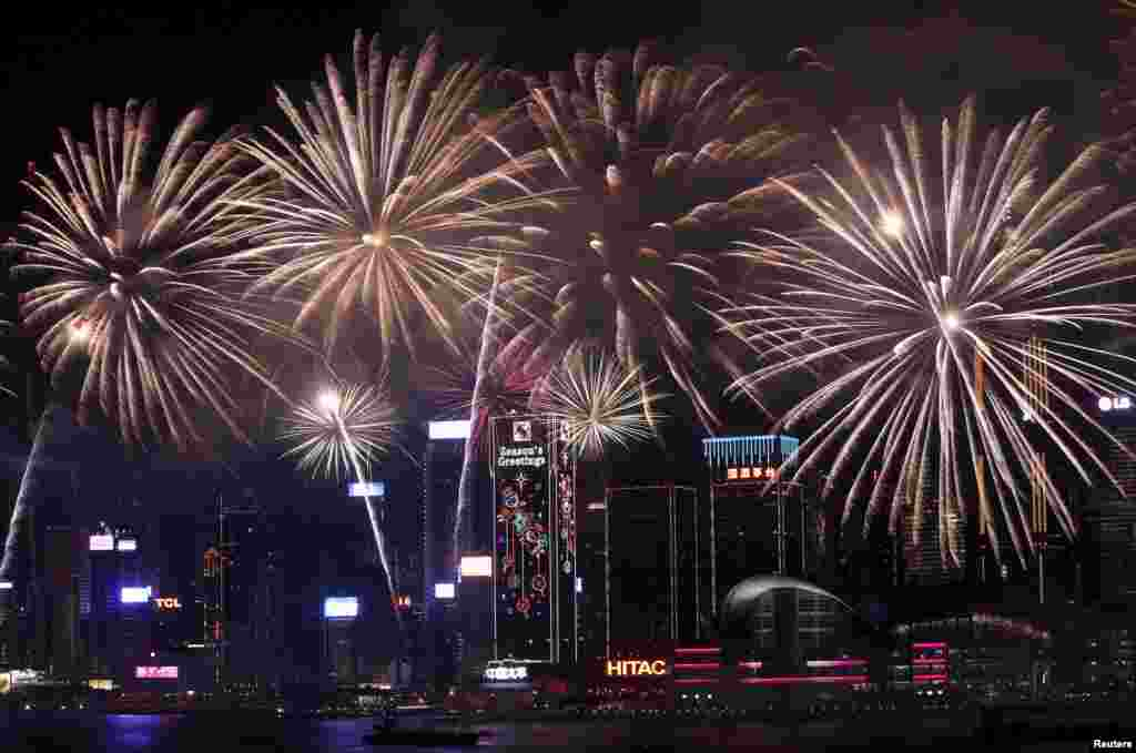 Fireworks explode over the Victoria Harbor of Hong Kong to celebrate the Lunar New Year of the Monkey.
