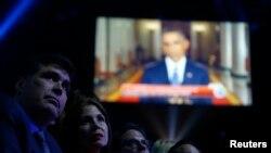Bài phát biểu về di trú của tổng thống Barack Obama được phát trên màn hình lớn, trước khi diễn ra lễ trao giải Latin Grammy Awards hàng năm lần thứ 15 ở Las Vegas, Nevada 20/11/2014.