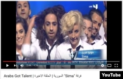 Hassan Rabeh (L) seen in YouTube screenshot from 2013 'Arab's Got Talent' reality talent show broadcast by MBC4 across the Middle East. Rabeh was a member of Sima dance troop,which won first place in the 2013 contest.