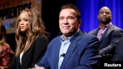 "FILE - Host Arnold Schwarzenegger (R) and Tyra Banks participate in a panel for ""The New Celebrity Apprentice"" in Universal City, California, Dec. 9, 2016."