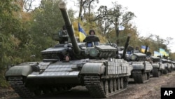 Ukrainian tanks move near Mariupol, Donetsk region, eastern Ukraine, Oct. 21, 2015.