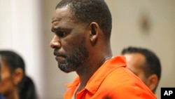 FILE - R. Kelly appears during a hearing at the Leighton Criminal Courthouse in Chicago, Sept. 17, 2019.