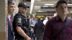 A police officer for Amtrak, the national passenger railroad, stands guard at Pennsylvania Station in New York on Friday
