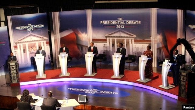 The eight Kenyan presidential aspirants Mohammed Dida, James Ole Kiyiapi, Uhuru Kenyatta, Peter Kenneth, Musalia Mudavadi, Martha Karua, Kenyan Prime Minister Raila Odinga and Paul Muite (L-R) face off in a presidential debate in Nairobi, February 11, 201