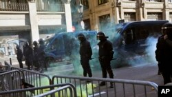 Catalan police secure the area from pro-independence demonstrators in Barcelona Spain, Friday Dec. 21, 2018.