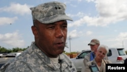 FILE - U.S. Major General Darryl Williams speaks to journalists at the Roberts international airport outside Monrovia, Oct. 9, 2014.