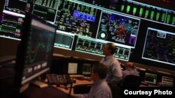 PJM manages the flow of electricity to 60 million customers in 13 US states from its control room in Valley Forge, Pennsylvania. (Courtesy PJM Interconnection)